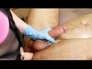 MILF in rubber gloves gives a prostate massage to a guy. And fucks him hard with a strapon..