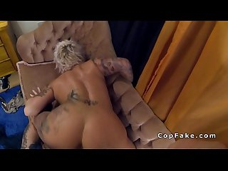Tattooed busty milf bangs fake cop on the sofa