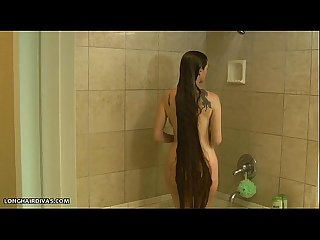 Busty longhair blonde milf shampooing in the shower