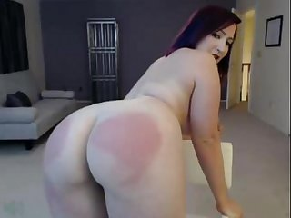 Girl with purple hair uses padle to Spank her