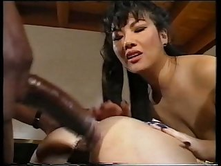 Two Japanese babes have fun with a BBC