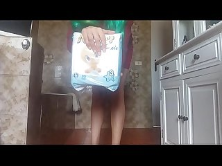 hot sexy diaperde girl PEE into her sexy tight dress and into a baby diaper