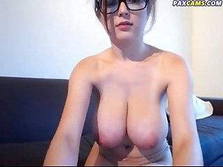 Redhead with glasses shows her massive natural tits paxcams com