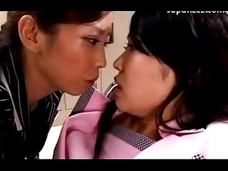 Asian girl in suits kissing passionately getting her nipples sucked in the locker room