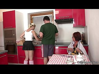 Future mother and teen toying at the kitchen