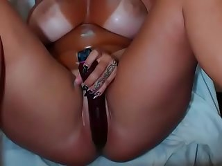 Sexy girl with sunburn skin masturbating alone on webcam