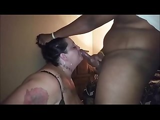 Fat slut sucking a black cock