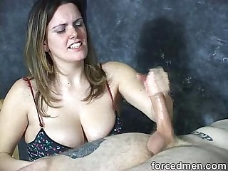 Big titted mistress masturbates and slaps A horny naked man s cock