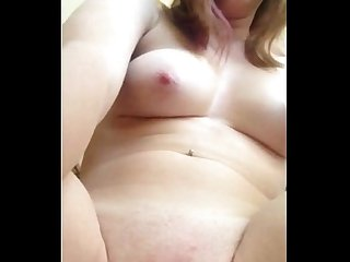 Fingering her shaved wet pussy until she cums