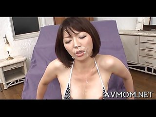 Pretty oriental hottie licking rod