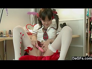 Little pigtailed asian puts her school clothes and masturbates on a chair