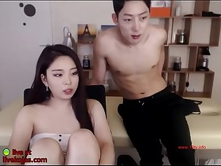 Korean gf in pantyhose plays with her man