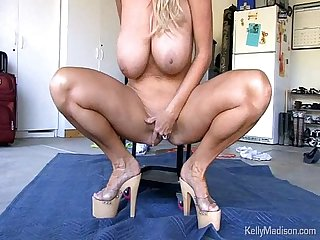 Milf with amazingly huge tits gets off in the garage