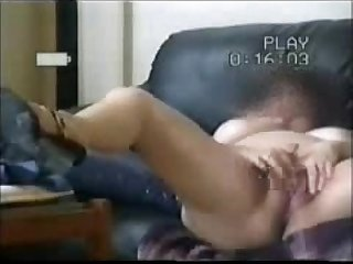 Hidden cam catches my mom home alone masturbating in living room