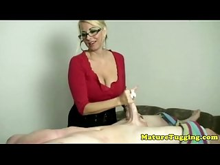 Blonde spex milf tugging his hard cock