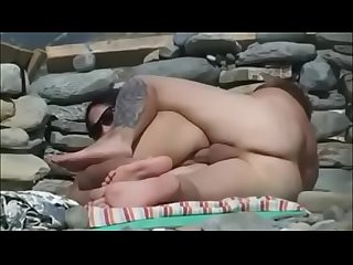 Couple sex at nude beach