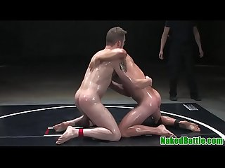 Oiled wrestling hunks fight before anal sex