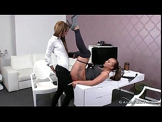 Female agent fucks brunette lesbian babe with cucumber