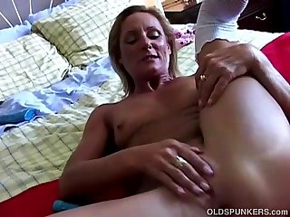 Super sexy old spunker in stockings fucks her soaking wet pussy
