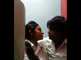 Ameture teen couple kissing in cafe