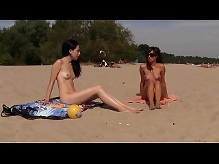 Teen nudist get naked and heat up a public beach