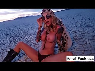 Sexy Tattooed hottie strips on a dry bed lake