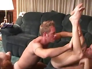 Three horny studs fucking hard in a threeway gay video
