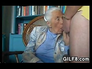 Naughty grandma giving a blowjob at home