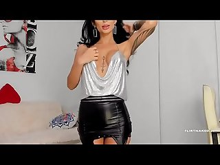 Very hot brunette in leather skirt, stockings and high heels cam show