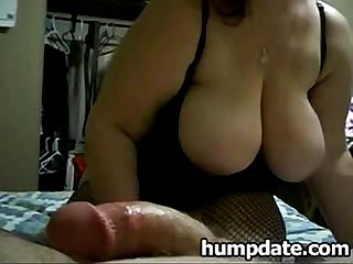 Chubby wife toys hubbys ass and gives handjob