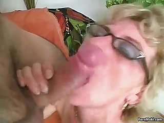 Hairy granny takes young cock
