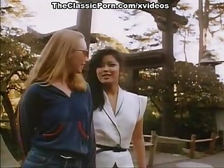 Chinees girl and sexy blondie in classic porn movie
