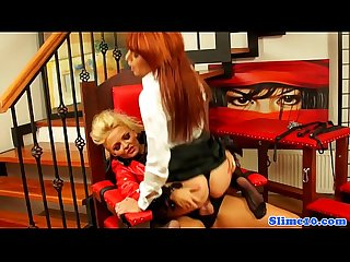 Femdom facializes redhead while bonded