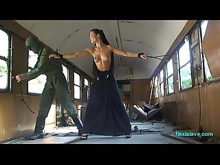 Bdsm model Alex Zothberg nude, oiled, captive and whipped in train