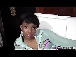 Ebony teen tugs facial