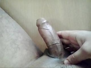 Masturbating dick with oil