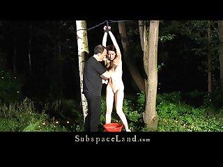 Redhead bitch restrained and fucked in the woods