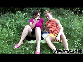 Milf and teenager enjoy outdoor sex