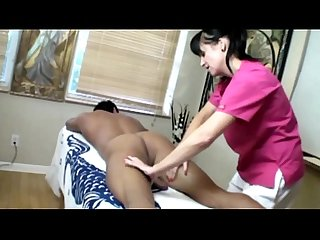 Mature masseuse tugging dick for her lucky client