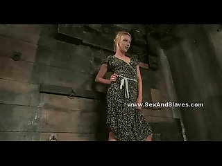 Blonde babe in long dress bondage video