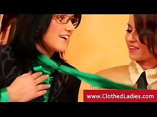 Three lesbians in stockings play with each others pussy