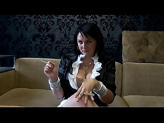 Goddess in sexy outfit and all in jewerly smoking 4 sigarets at once