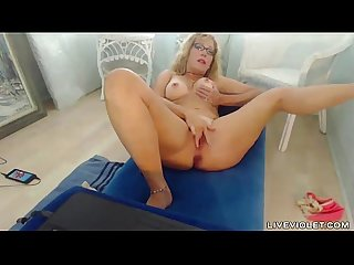 Pale cougar squirter with glasses masturbates vagina