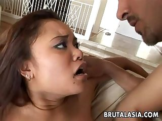 Stunning asian gal enjoys two huge dicks