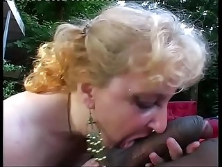 Mature woman sucking a young big black cock