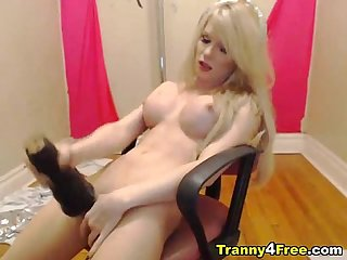 Busty hot blonde tranny licks her own cum