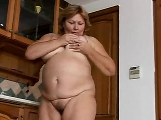 A hairy bbw granny wanks and urinates