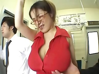 A big boobs asian milf without a bra on train pt2 on hdmilfcam com