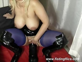 Gigantic dildo fucking blond housewife