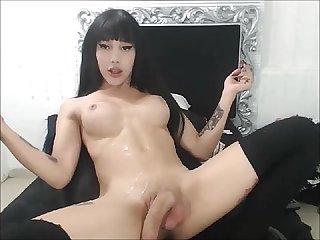 Brunette TS Doll's Huge Cum Explosion